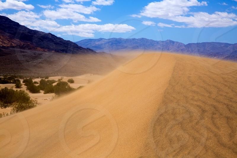 Mesquite Dunes desert in Death Valley wind sand storm detail on dune tip photo