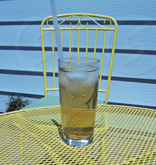 clear drinking glass on yellow table photo