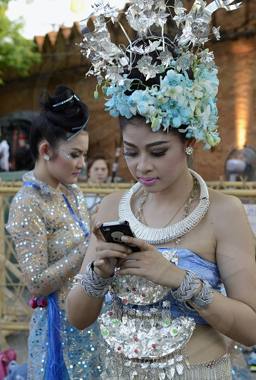 a group of Thai dancers at the Citywalll in the city of chiang mai in the north of Thailand in Southeastasia. 