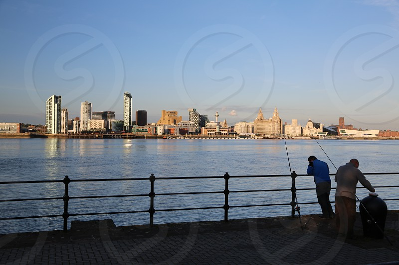 Liverpool skyline cityscape River Mersey anglers fishing photo