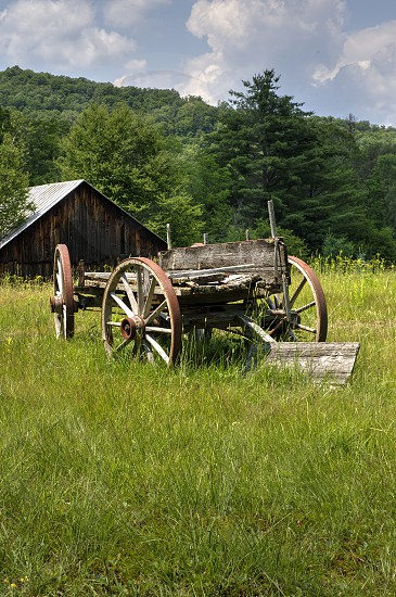 Old wagon and barn in a country setting photo