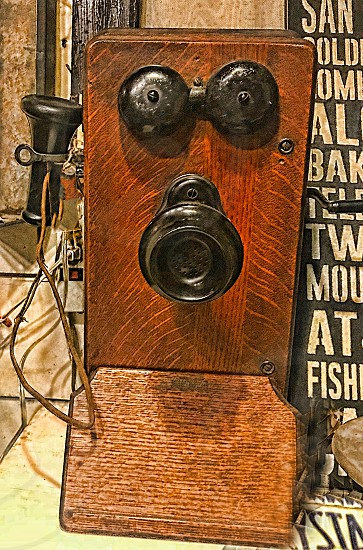 Old fashioned wooden telephone with a speaker photo