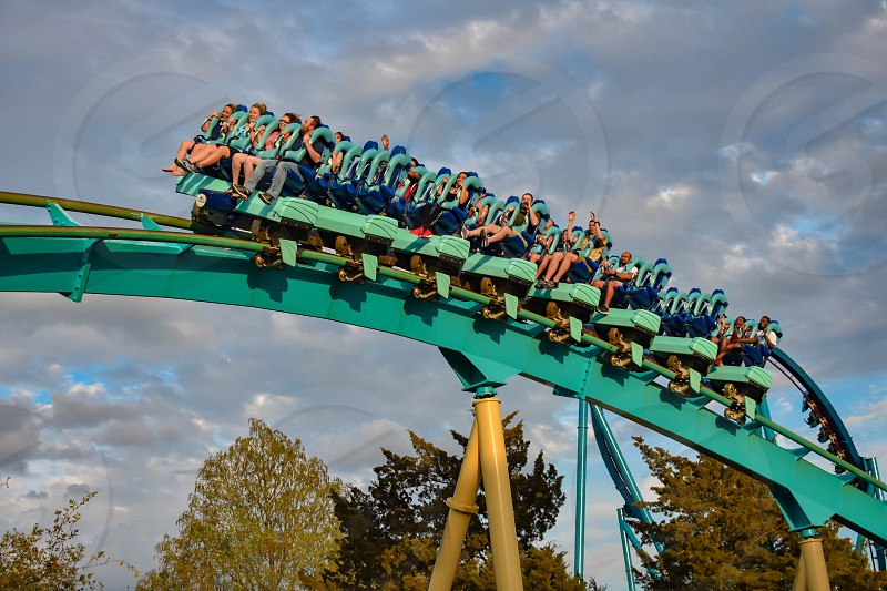Orlando Florida. March 05 2019. People having fun Kraken rollercoaster at Seaworld Marine Theme Park (8) photo
