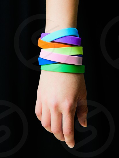 blue purple yellow and green silicone band photo