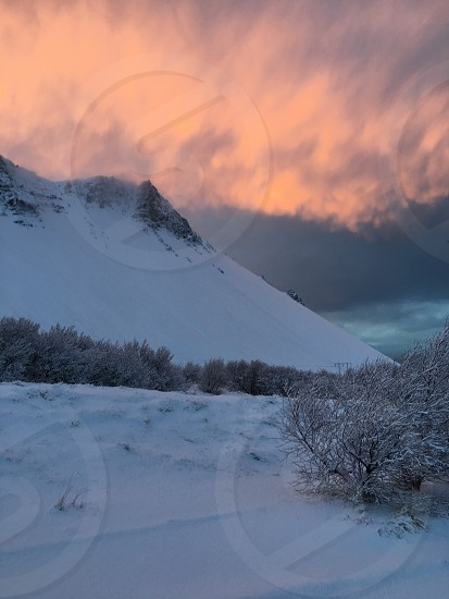sunset over an icelandic mountain photo