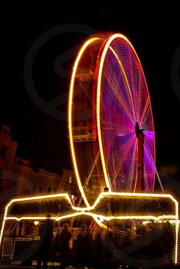 carnival ferris wheel night long exposure amusement festival fun fair photo