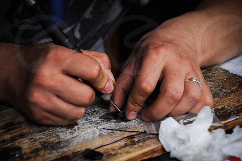 Pendant Engraver Guiyang China Engraving Glass Hand Carving Chinese Craftsman photo