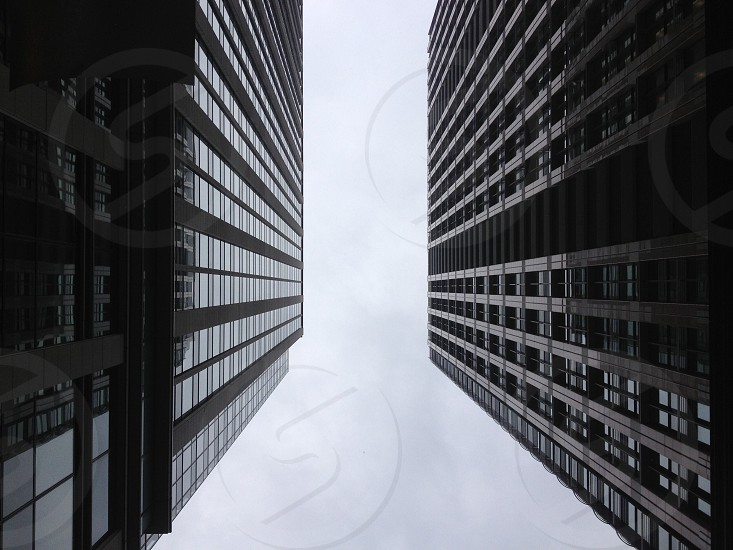 2 high rise buildings bottom view photo