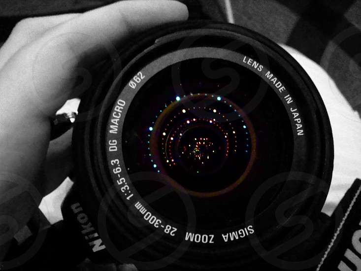 Lights reflected in a camera lens photo