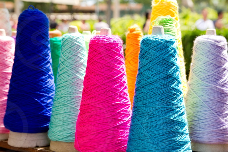 Embroidery colorful thread spool in rows photo