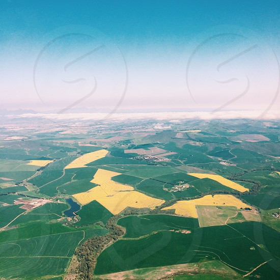 From above aerial view view landscape high green land patch fields birds view photo