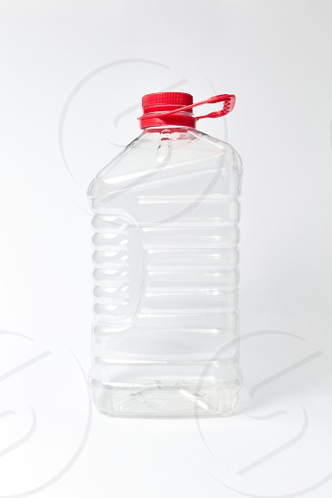 Big plastic transparent empty container for water and different liquid on a light gray background mockup. Place for text. photo