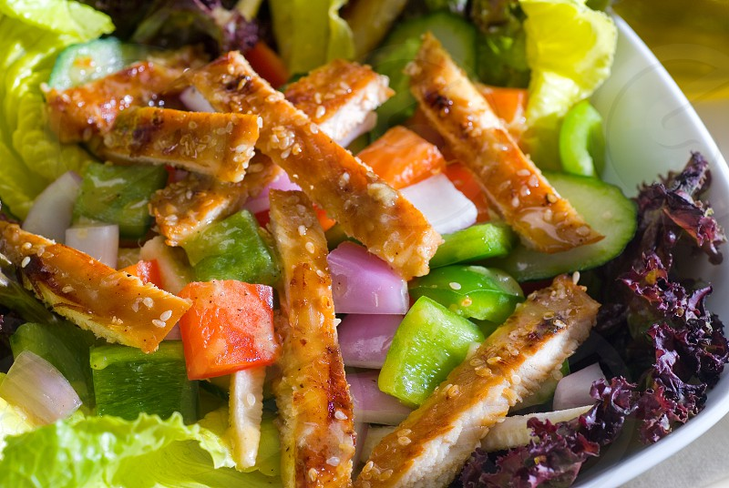 fresh colorfull sesame chicken salad close up photo