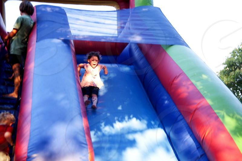 Girl on inflatable slide photo