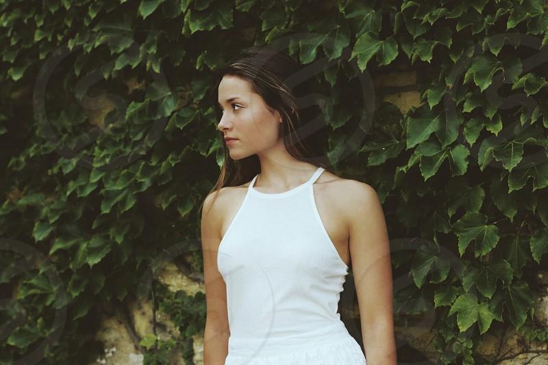 woman wearing white sleeveless shirt photo