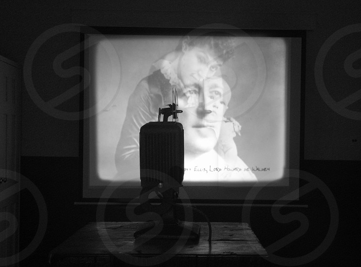 Chasing light. Oldie. Projector. Dark. photo