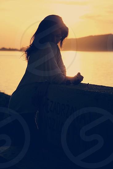 Sunshine river portrait of a beautiful woman photo