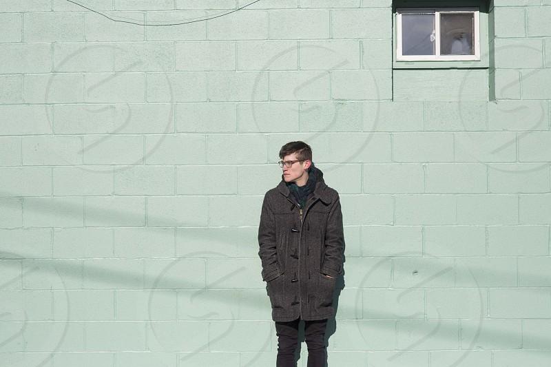 men's black zipped up jacket photo