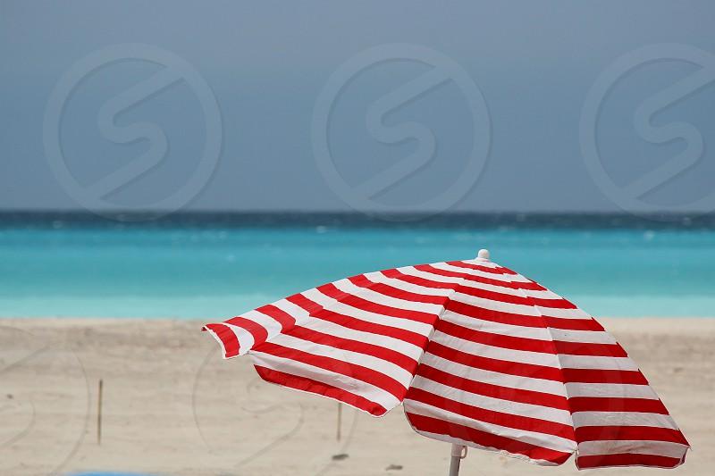 beach sand horizon beach umbrella red&white photo