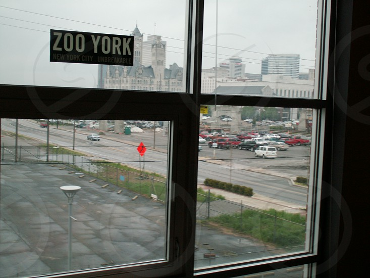black framed glass window with zoo york sticker photo