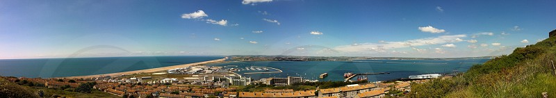 Wide panorama from Portland prison looking over Lyme Bay and Portland harbour on Dorset's Jurassic coast  England  photo