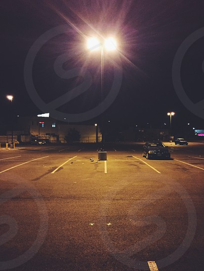 black car parked on parking lot photo