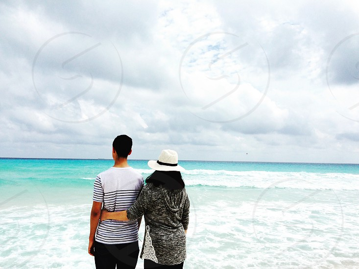 Beach mexico blue sky ocean water clouds looking out hat travel  photo