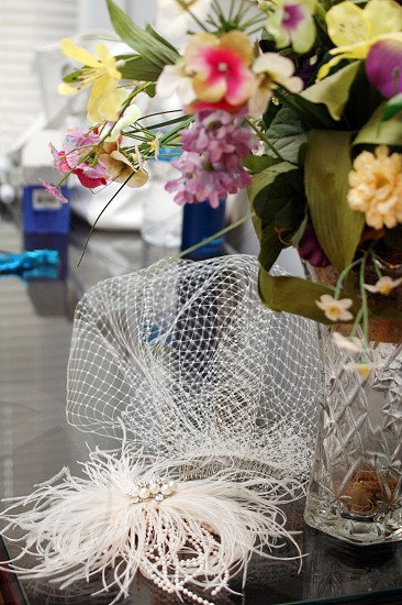 A bride's veil and flowers before a wedding photo
