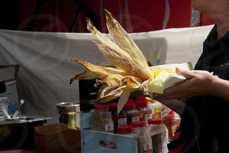 Corn spices fresh organic fair butter food vegetables farmer husk sunny food truck concession stand hand eat photo