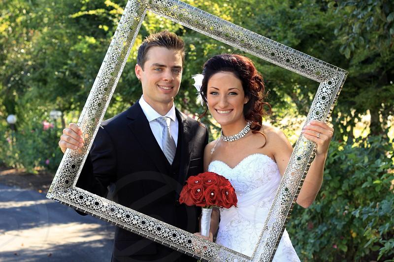 wedding photo taken near green tree photo