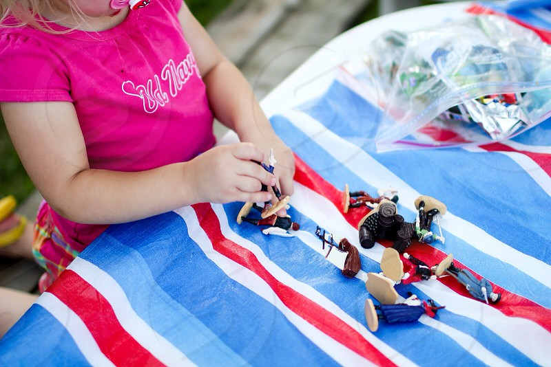girl playing plastic toy photo