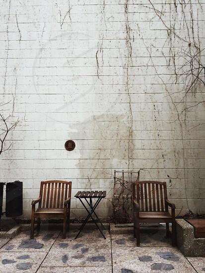 brown wooden armchair on gray floor tiles photo