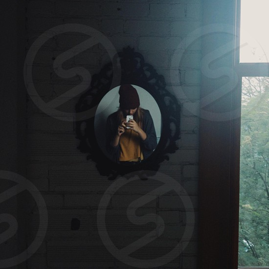 black round framed wall mirror photo