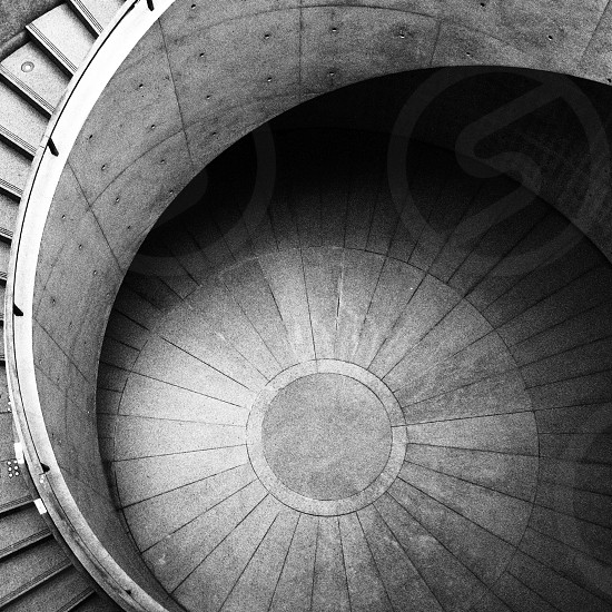 gray scale spiral stairway photo