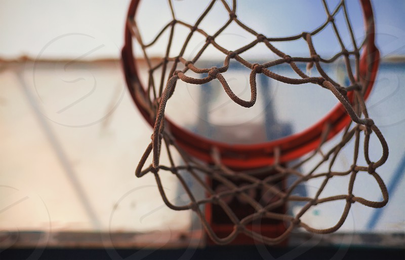 Details of basketball hoop and old net.  photo