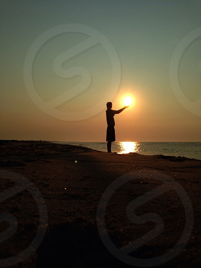 man standing in sunset view photo