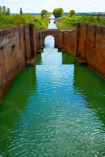 Canal de Castilla Channel by Saint James Way in Fromista Castilla Leon of Spain photo