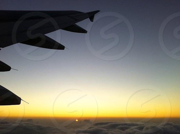 silhouette airplane sunset photo