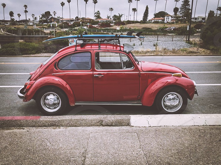 VW Bug with surfboard photo