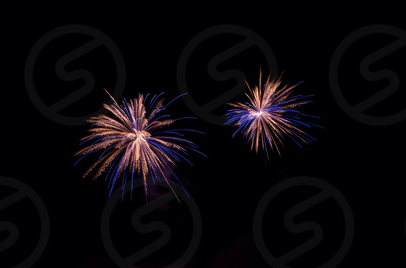blue and yellow fireworks photo