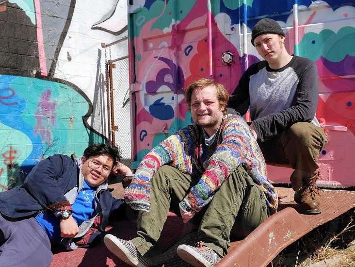 Three guys best friends hanging put chilling street kids photo