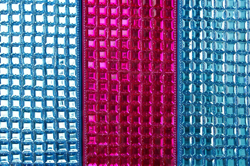 Colorful sequins macro closeup texture background sewed fabric photo