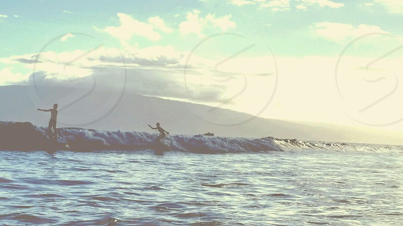 people surfing photo