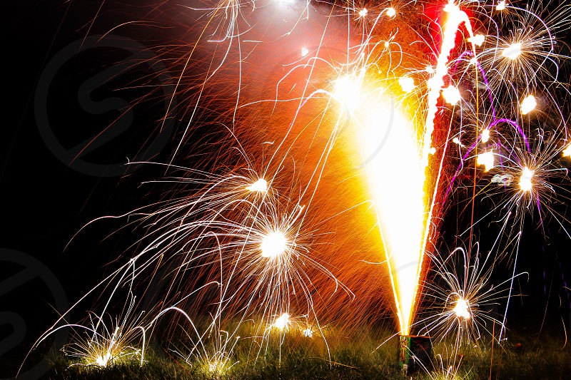 yellow and red fireworks photo