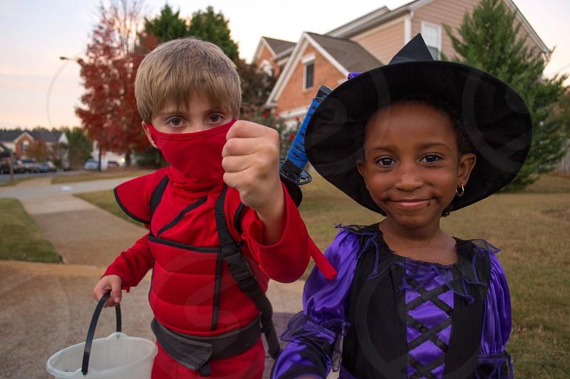 Halloween witch ninja boy girl friends trick or treat costume  photo