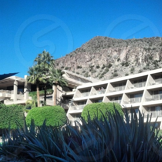 Camelback mountain looks down on the Phoenician Spa in Scottsdale AZ. photo