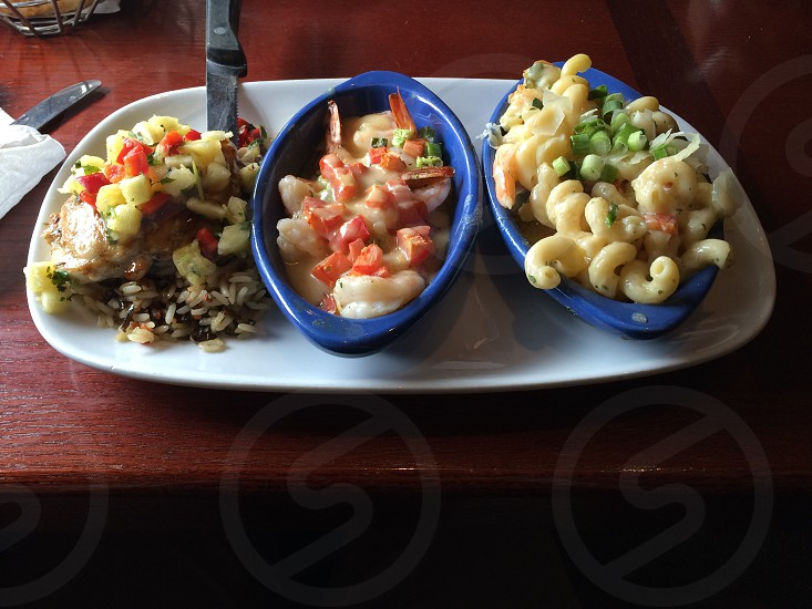macaroni and fruit salad on blue ceramic bowls photo