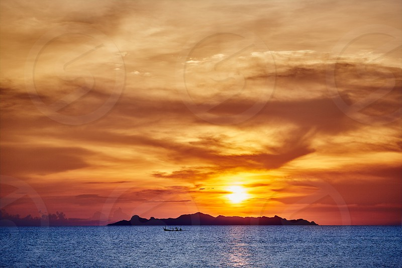 Tranquility moment of blue sea against the red sky during sunset The beauty of nature photo