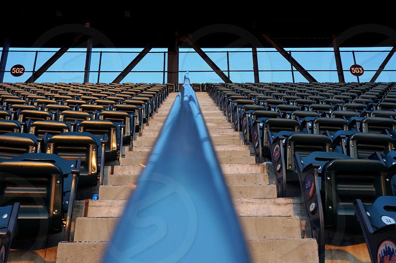 blue staircase handrails and blue and black folding side chair photo