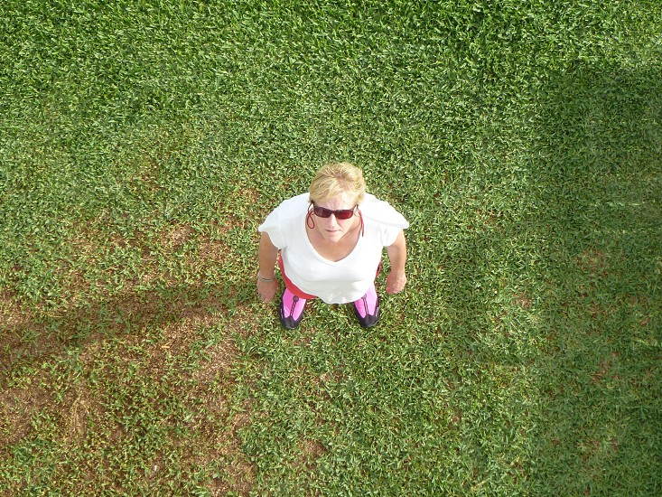 Aerial photo of a standing mature woman... photo